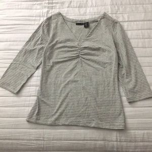 Grey/white striped 3 quarter sleeve shirt.
